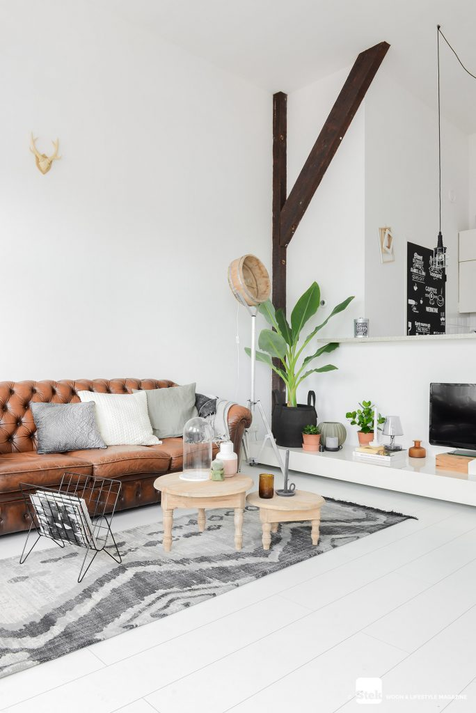 Chesterfield bank in stoere woonkamer